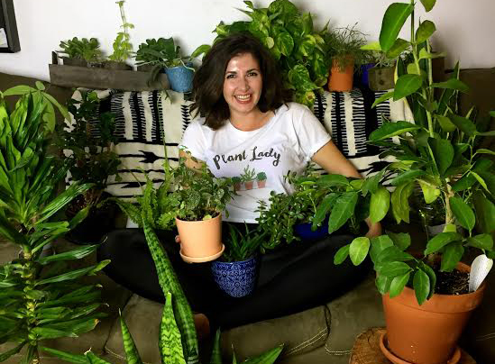 Maria of Bloom & Grow Radio in her element: surrounded by plants!