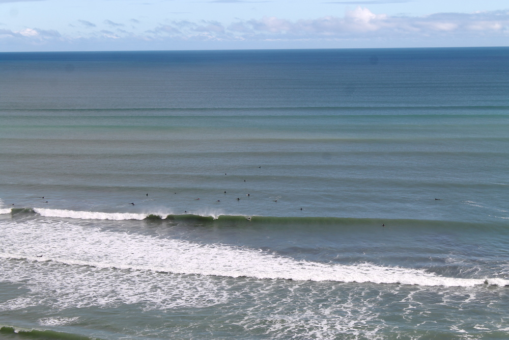 Note the tiny specks of surfers.