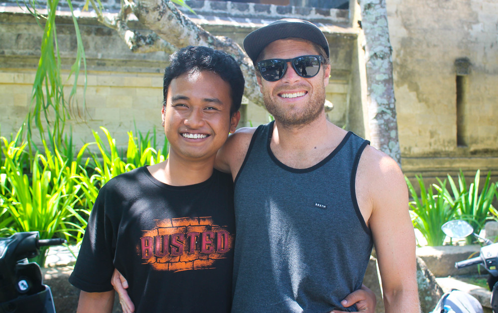 "Zali + Scott. Zali ran the villa we stayed at and we could often find him and his friends smoking cigarettes and playing Guns N Roses covers out by the entrance. You haven't lived until you've heard the Indonesian acoustic version of ""November Rain"""