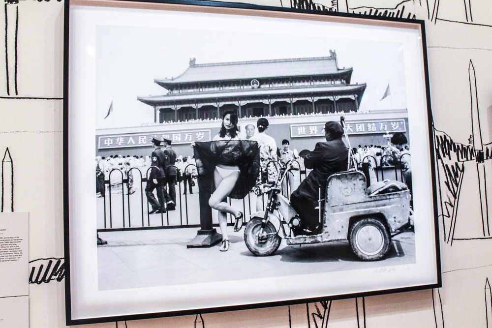 Ai's wife, Lu Quing, lifting up her skirt at Tiananmen Square.