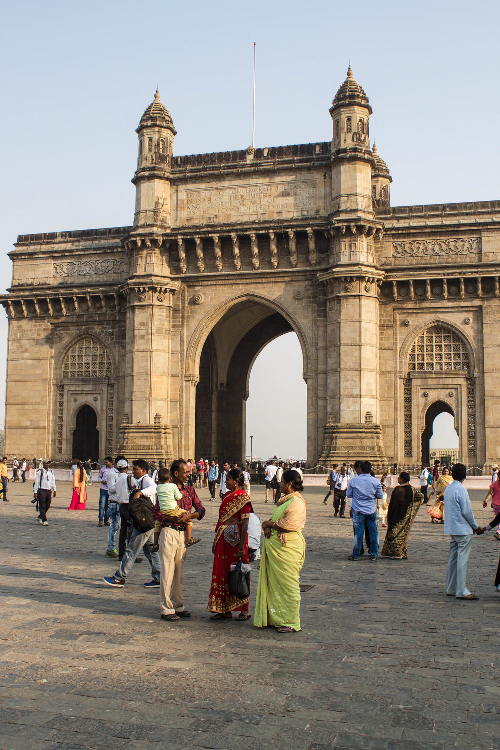 "Gateway of India: a monument that was erected to commemorate the landing of King George V and Queen Mary at Apollo Bunder (a pier) on their visit to India in 1911. For the British arriving to India, the gateway was a symbol of the ""power and majesty"" of the British Empire but today it serves as a ""monumental memento"" of British colonial rule over India."