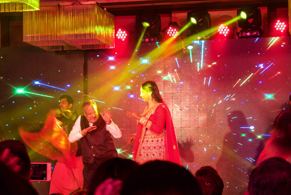 Mr. and Mrs. Rao (TJ's parents), tearing up the stage.