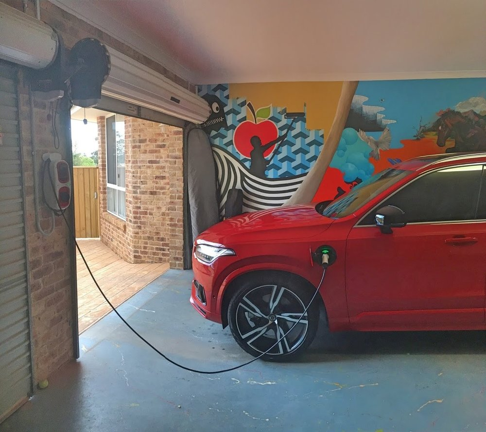 A Volvo XC90 T8 charging from the Wallpod