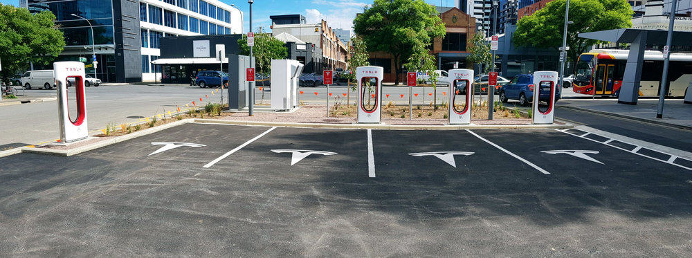 Tesla V2 chargers and parking