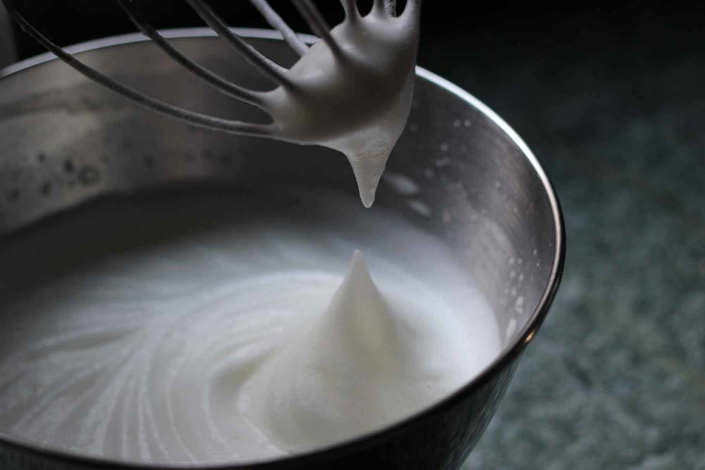 Egg whites beaten to creamy stiff peaks. Avoid over-beating as it dries the whites out and they don't fold as easily.
