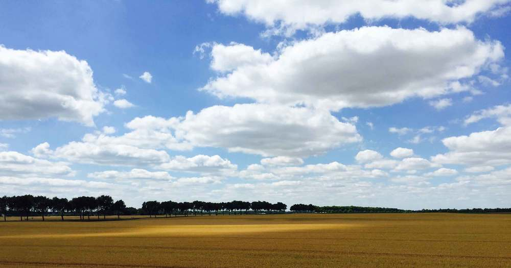 Loire valley wheat field, beautiful clouds, cloud collectors, handmade accordion photo book project by Thread & Whisk