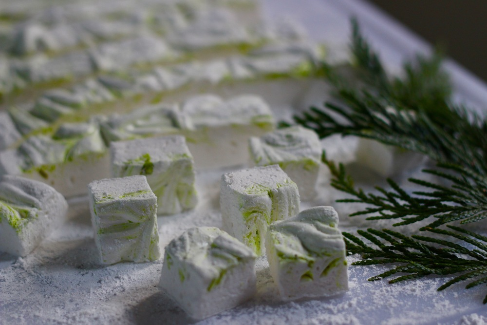 Once you have tried homemade marshmallows, you will never be able to go back to the mass produced variety.  This is a board of square-cut marshmallows flavored with pistachio paste