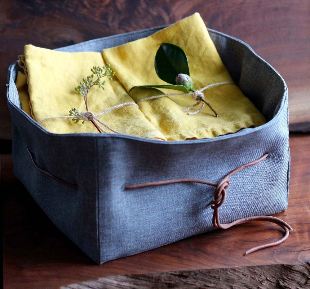 A sewn box to hold our cloth napkins.  Great kitchen to table idea.  Sewing instructions at Thread & Whisk.
