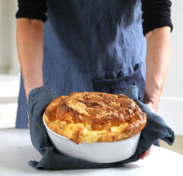 Yummy cheddar and bacon soufflé recipe by Thread & Whisk, Grace Apron in Indigo with Midnight Flounce, handmade in Portland, Oregon