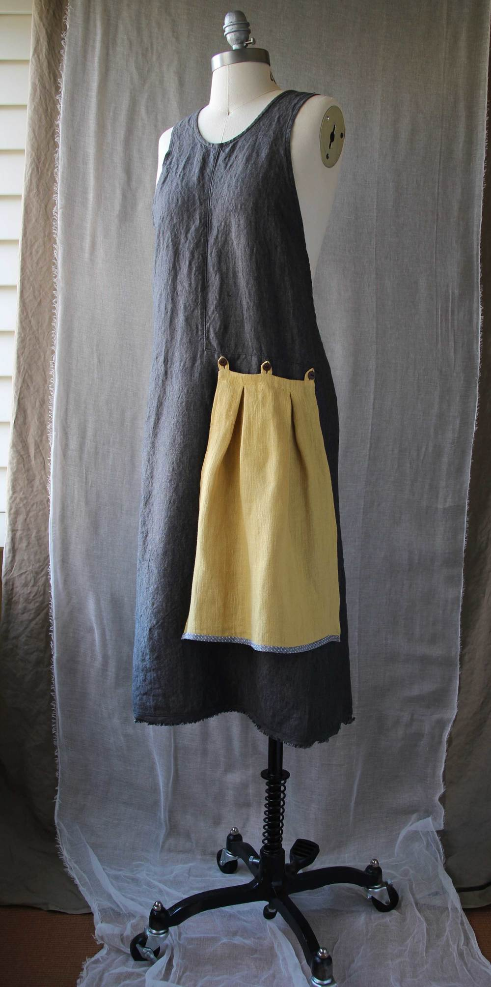 Charcoal Grace Apron with Goldenrod Flounce, designed and sewn in Portland, Oregon by Thread & Whisk