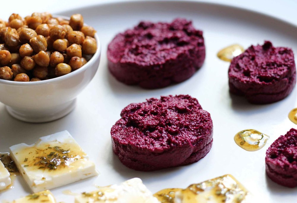 Replacing chickpeas with beets, we lighten and brighten our winter mezze plate.  It's ok, there are some roasted chickpeas on the side, lest you miss them.  Adding a rosemary-infused honey drizzle over some feta completes a sweet, savory, crunchy, creamy mezze plate.  Just add warm flatbread or pita.  Yum.