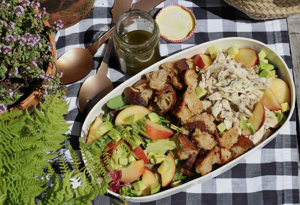 top-view-of-chicken-peach-avocado-salad-on-table.jpg