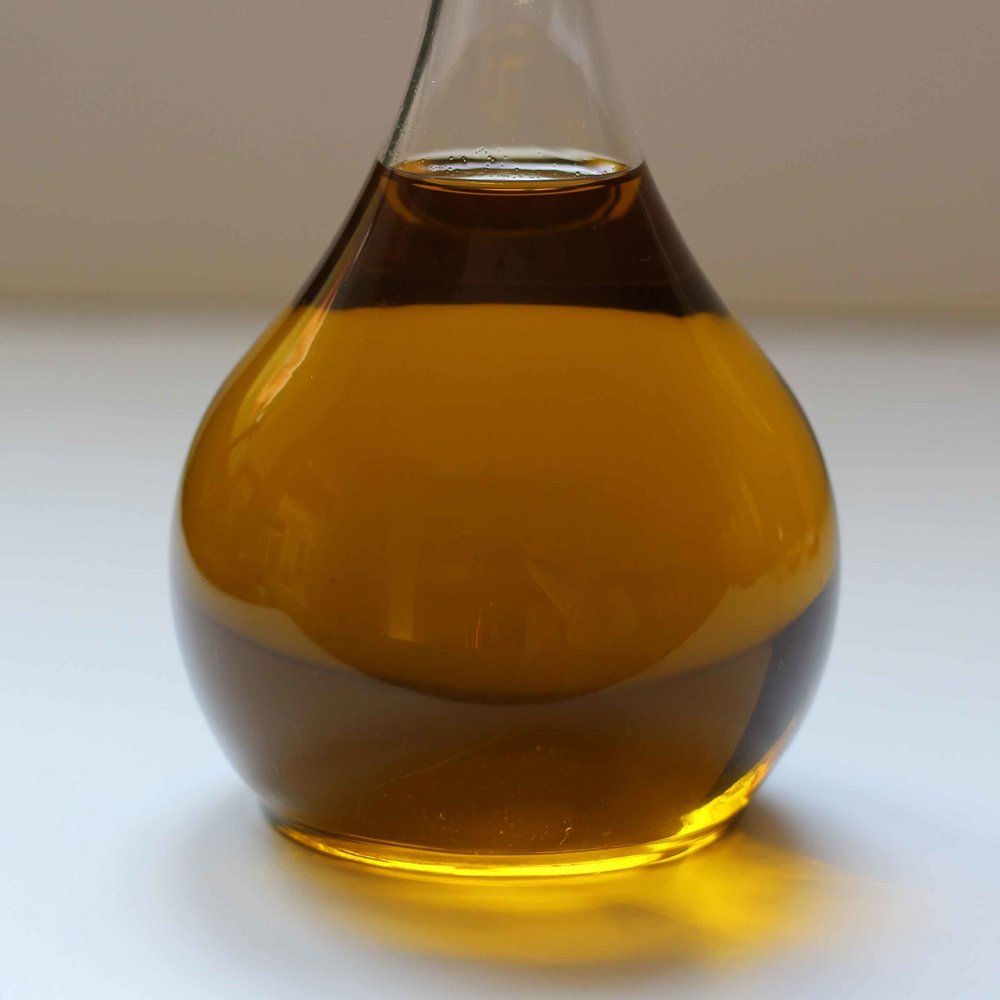 A bottle of olive oil with a beautiful gold color.  It is wise to use excellent olive oil when making a pared down salad.  Every ingredient is important.