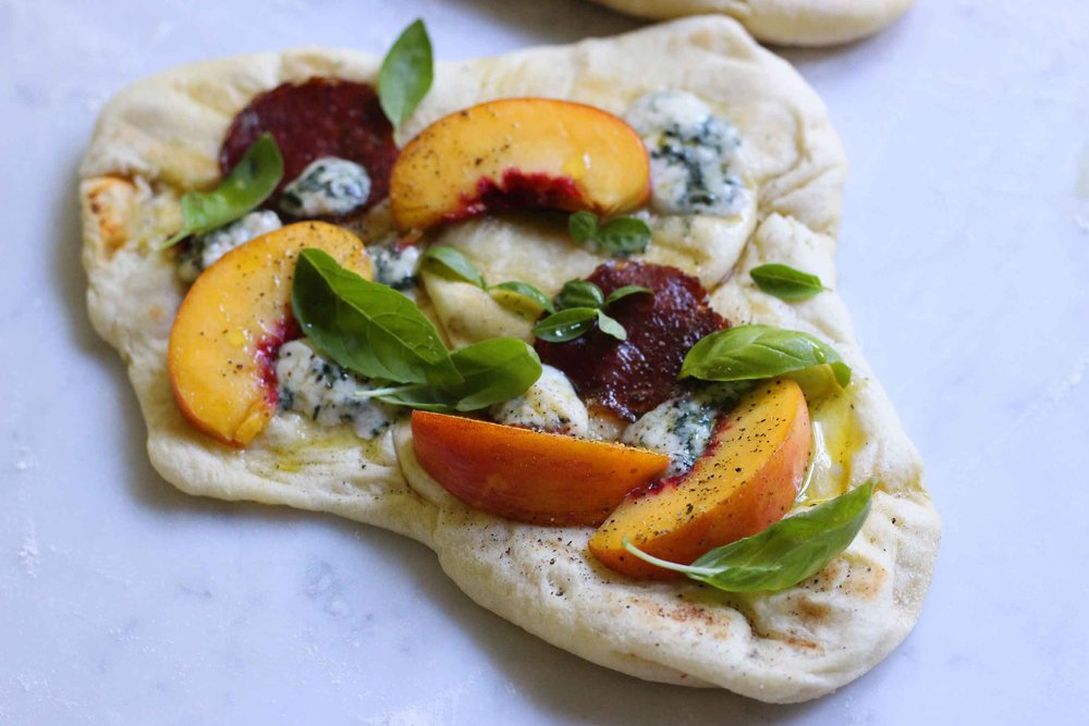 A late summer, grilled mini pizza with fresh peach and basil, spicy salami, and blue cheese.  The flavor combination makes the most out of the peaches with a unique twist.  | Recipe at threadandwhisk.com