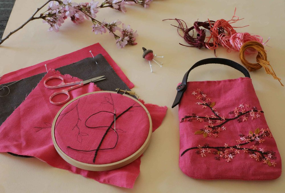 The view from our seat as we start to stitch our second plum blossom pouch.  Made of pink linen, leather, and embroidery threads, it is a simple yet beautiful construction.