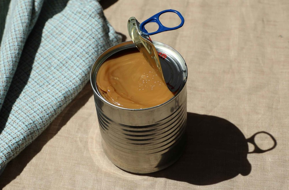 Who knew that you were only 2 hours away from turning a can of sweetended condensed milk into dulce de leche? Find out how to accomplish this HACK.