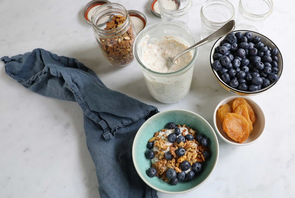 All the components of a tasty breakfast. Yogurt soaked steel cut oats, and a chai flavored nut and seed mix topped with fresh blueberries. Make a batch on Sunday and be happy ever morning next week!