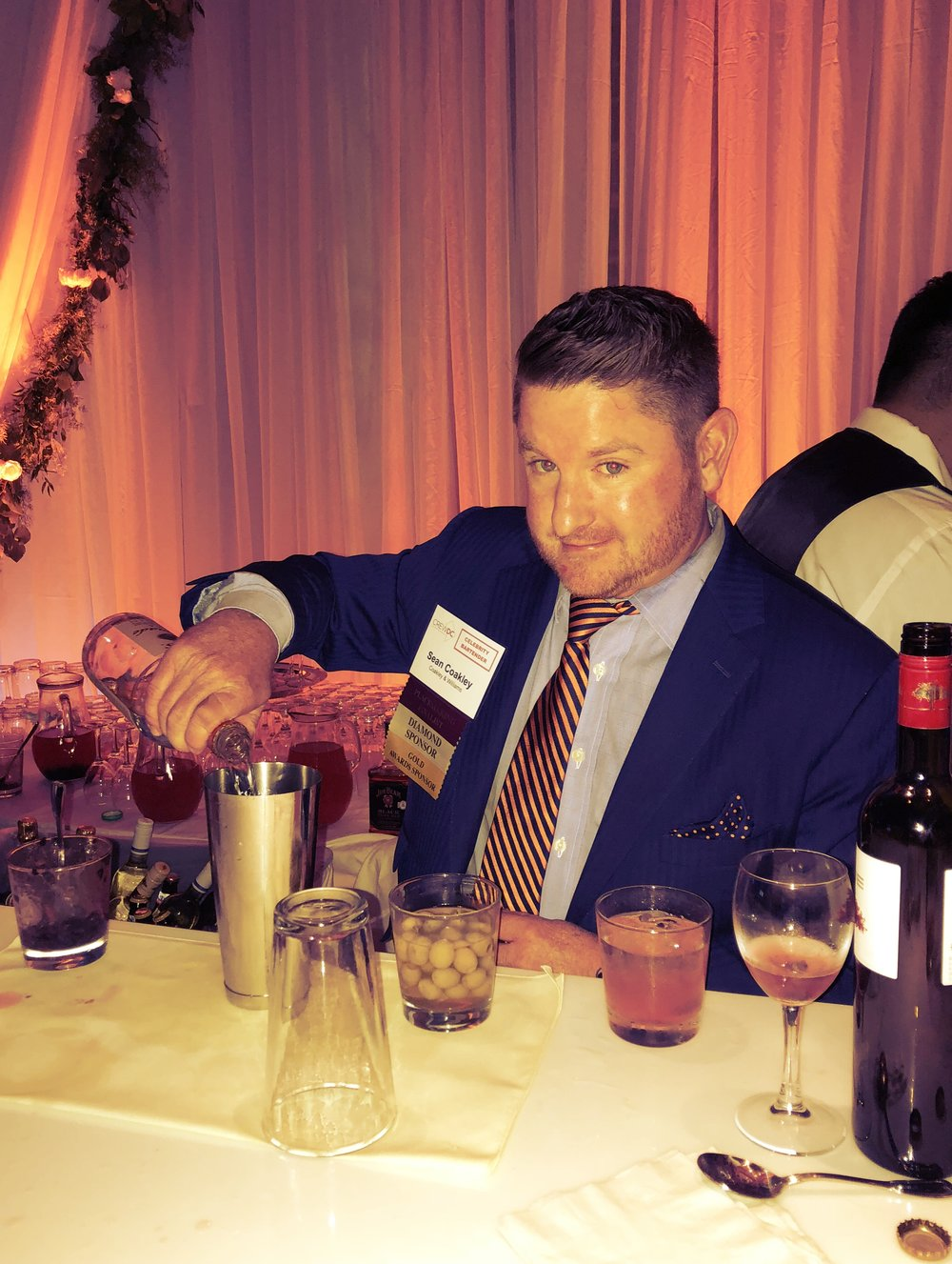 Coakley & Williams Construction's Senior Vice President, Sean Coakley, mixed cocktails as one of the evening's celebrity bartenders