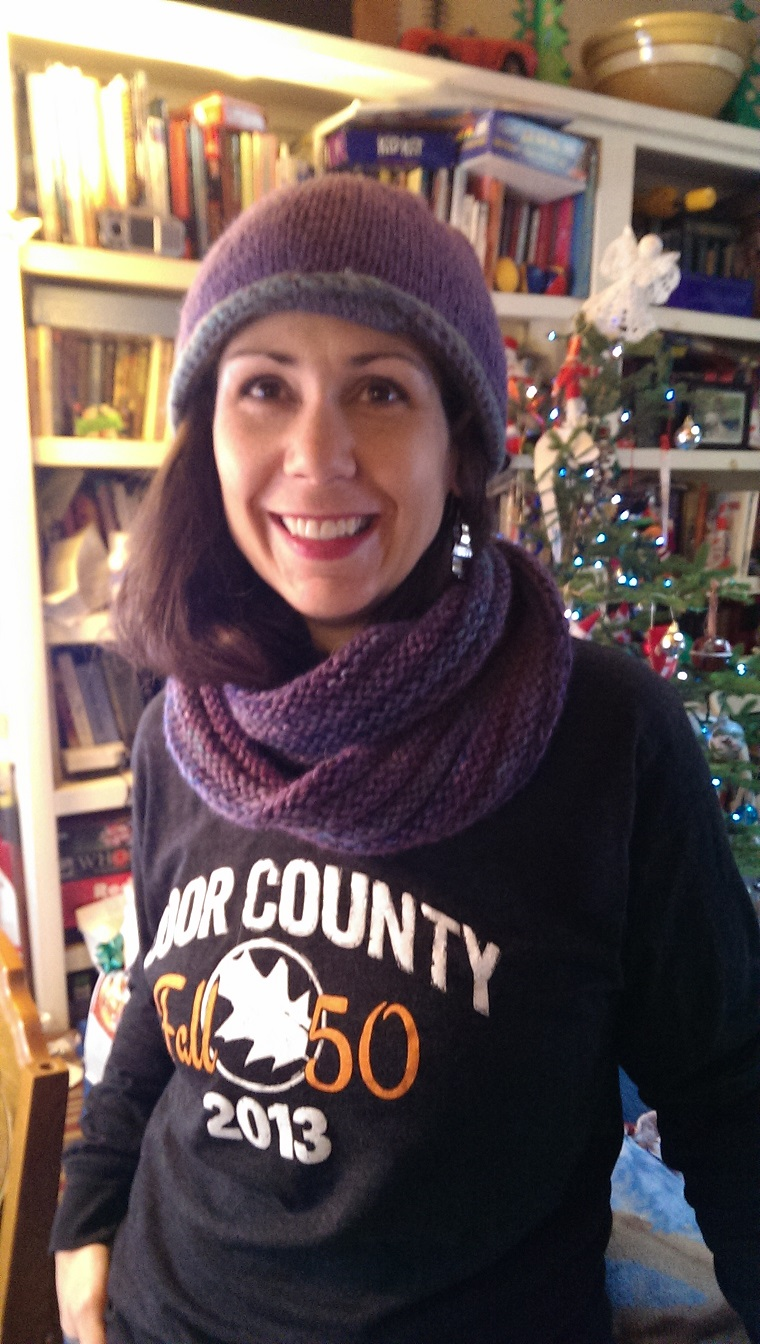 Jenn modeling a hat and moebius cowl she made last Christmas