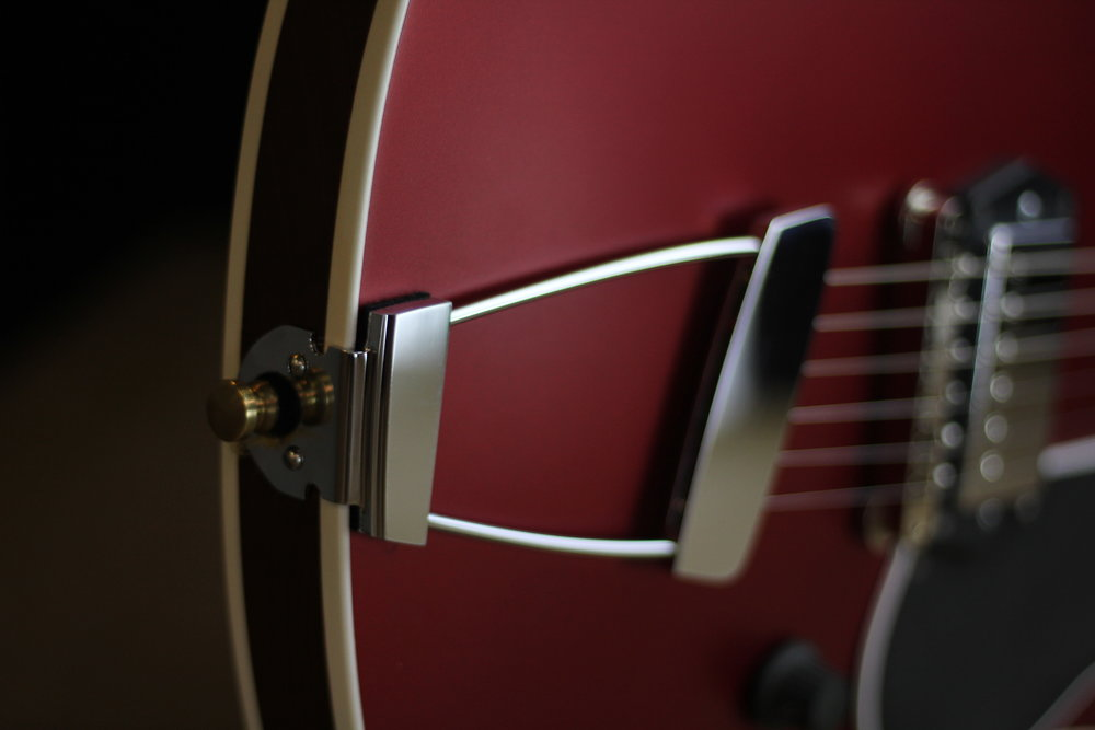 Proprietary Floating Tailpiece