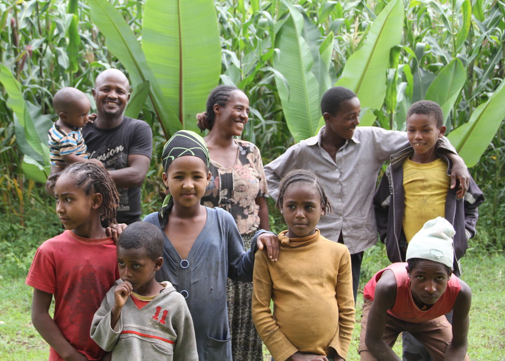 Farmer Hannah Mengistu (back center) of Butajira, Ethiopia with her husband and family