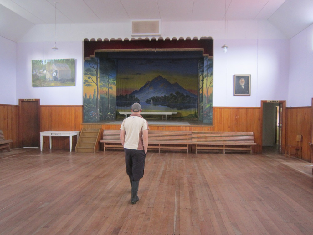 Our guide (note the gumboots) inside the Memorial Hall.JPG