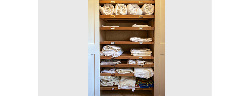 Interior of linen - ceder shelving