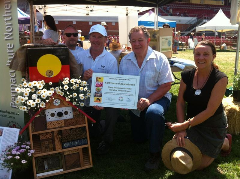 PNB and Warringah Council awarding Neil Evers and the Aboriginal Support Group, with 'Ngarruu' - a native stingless bee hive.
