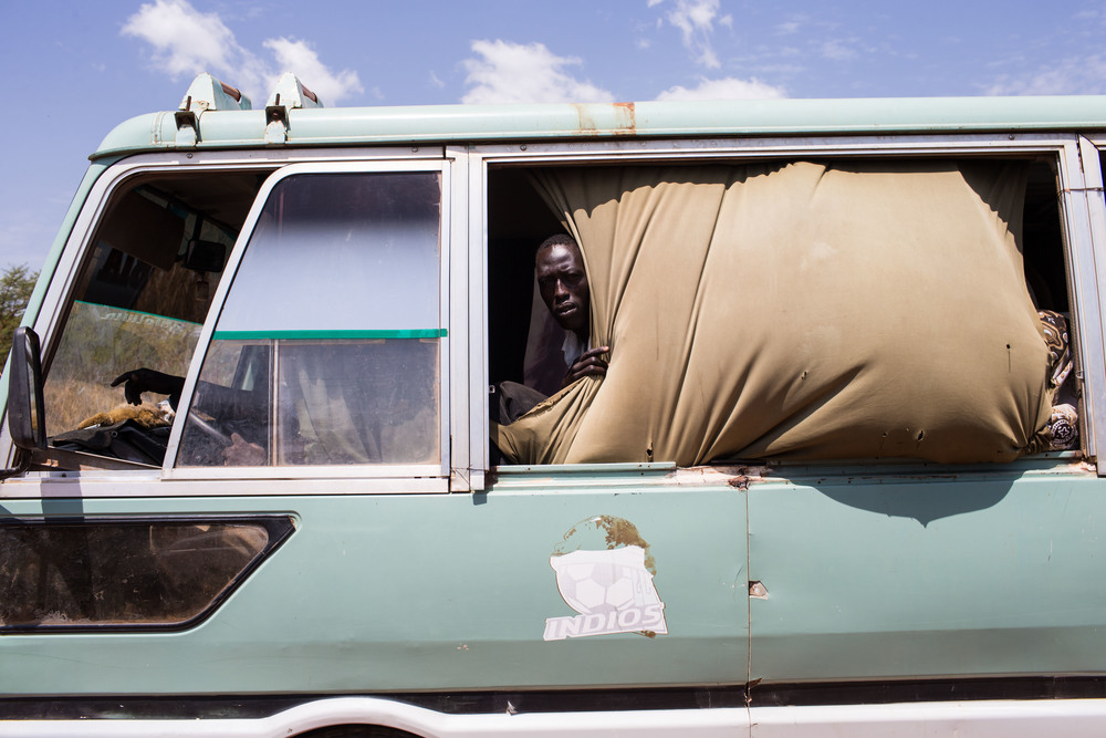 People travel from Agok, South Sudan to Abyei by bus. 64,775 people registered to vote in Abyei's referendum, many of whom were displaced by previous fighting but returned to Abyei to vote.