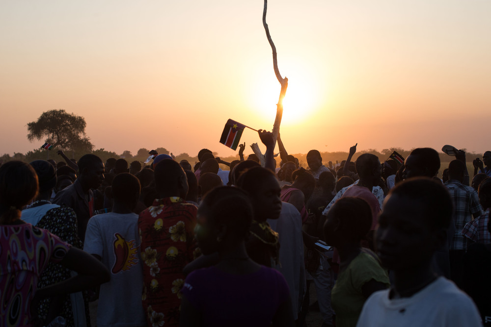 Dinka Ngok dance and run around a central tree trunk in celebration of the referendum results to join South Sudan.