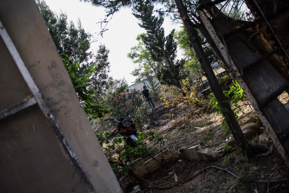"A rebel named Hassan walks through the trees behind the base. ""Their [regime soldiers'] bullets have my name inscribed on them. All of them,"" he says one afternoon, alluding to his desire to be a martyr."