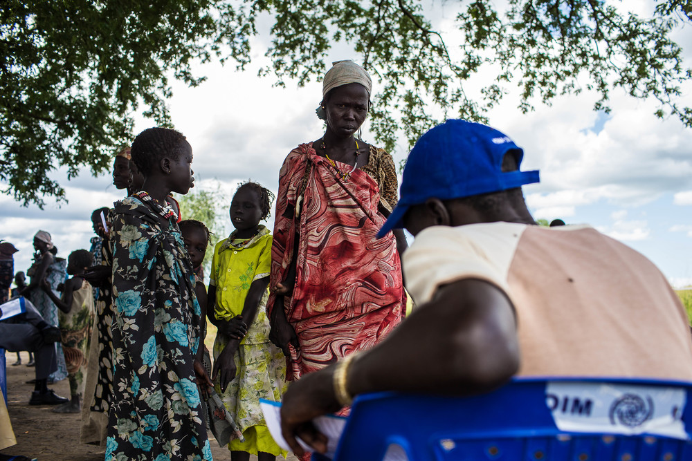 A mother and daughter register for a UN food distribution in Gumuruk, Jonglei State, South Sudan. More than 23,000 people, many of whom came out of hiding in the bush recently registered to receive food in Gumuruk.