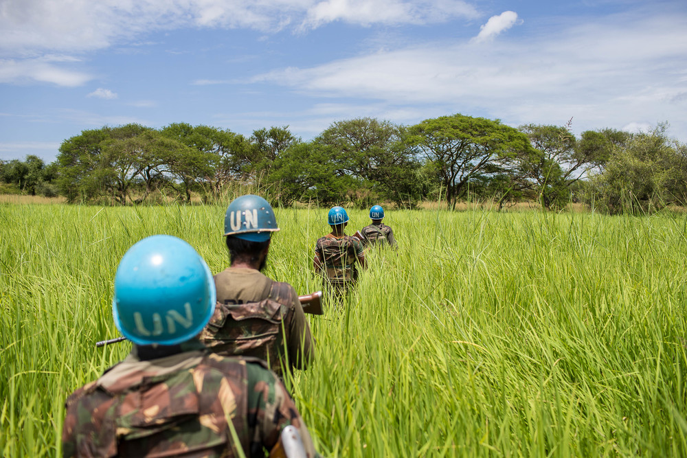 A group of Indian UN Peacekeepers patrol outside Gumuruk, Jonglei State, South Sudan. The battalion of UN Peacekeepers stationed on the edge of town carry out frequent patrols along the perimeter of Gumuruk in order to monitor for rebel activity.