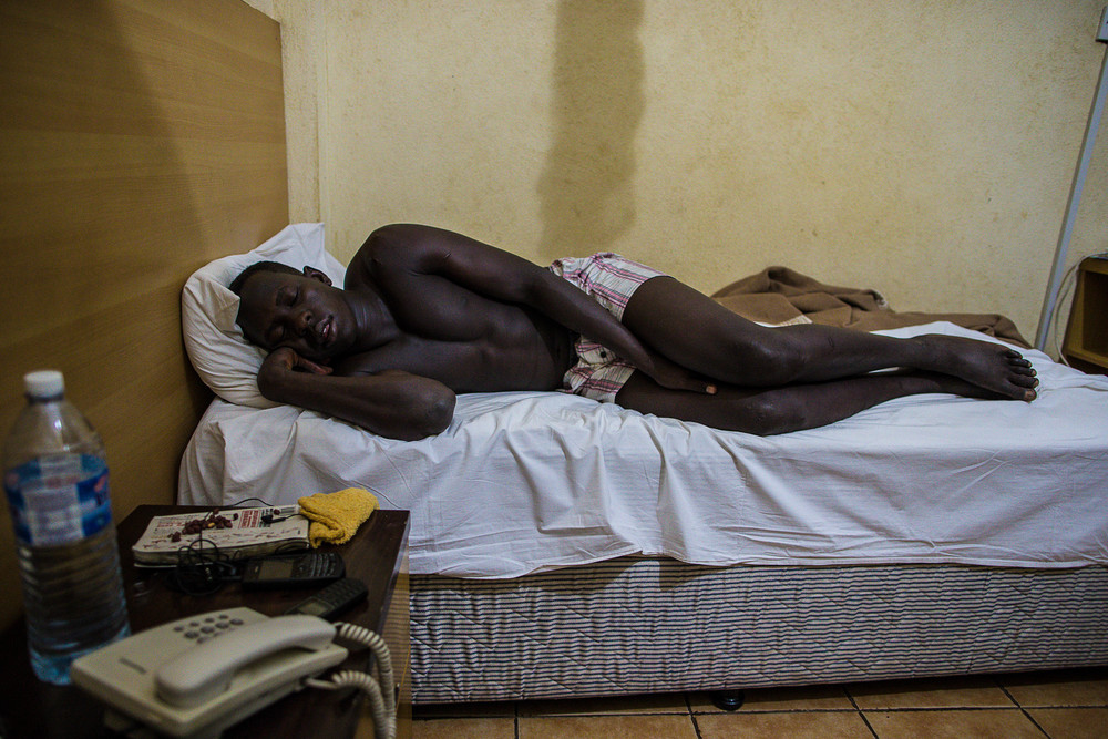 "Abayok takes a nap in his room. ""I want to be the greatest,"" he says when asked about his hopes for kickboxing, ""and I want to travel the world."""