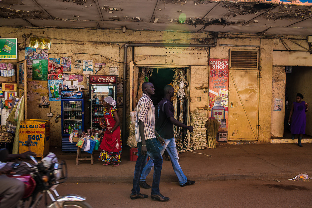 "Izekal and Kuol (left to right) walk through the streets of Kampala. ""The fight is not what's really important,"" says Puro, ""I want these guys to open their eyes."""