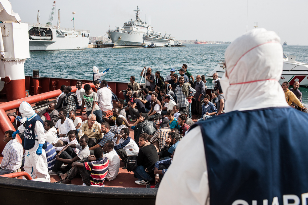 A boat of rescued migrants arrives to Augusta, Sicily.