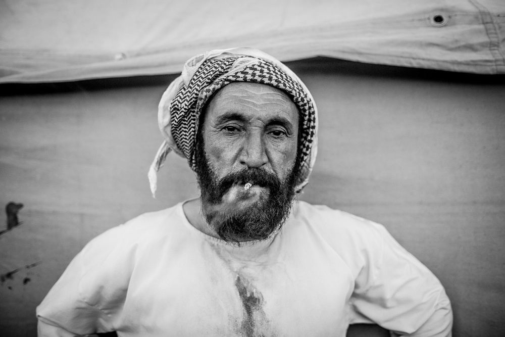 """I thought we would die on that mountain,"" says Darwesh as he smokes a cigarette outside the canvas tent that will be his new home, ""but we heard they [Kurdish fighters] had cleared a corridor leading into Rojava [Syria] so we thought it was better to try. We thought that would be a better death."""