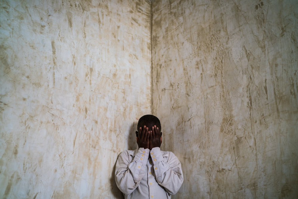 Abubakar Adam, 12, stands for a portrait in Maiduguri, Nigeria, Sunday, May 29, 2016. Abubakar was kidnapped by Boko Haram three years ago and forced into their service at a remote outpost in the forest. Mackenzie Knowles-Coursin for The Wall Street Journal.