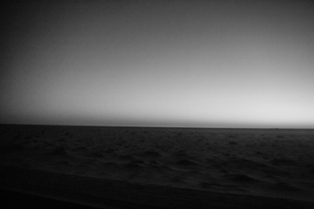 The sun rises over the Sahara as the car speeds north through Mauritania.