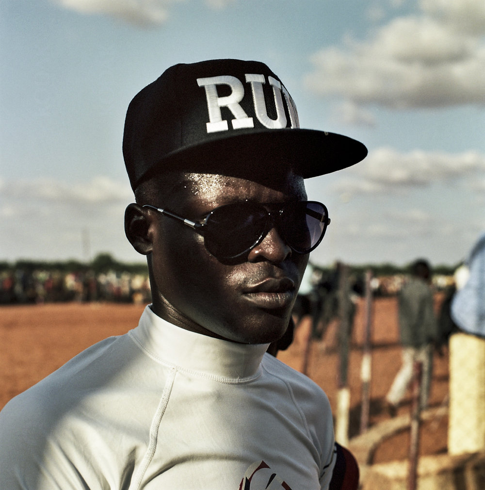 A jockey sweats under the sun. Temperatures can easily rise above 110 degrees.