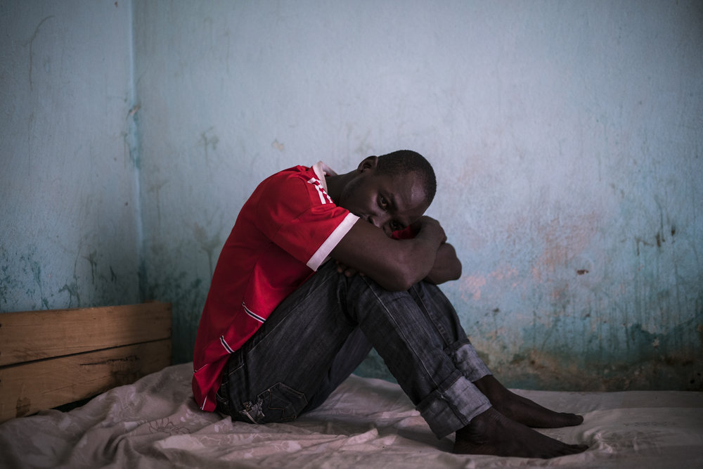 """It took me about a week to stop but it was so difficult...I decided not to go out of my house because I knew if I saw it I would take it,"" says Hussein, 28 of quitting tramadol after taking it for five years, ""My body was broken - I felt horrible, my head and my stomach were on fire, but I resisted."" Garoua, Cameroon. 2016. Hussein's older brother Musa died from an overdose of the drug the previous year. ""I tried to stop him many times and for many years but he wouldn't listen to me.