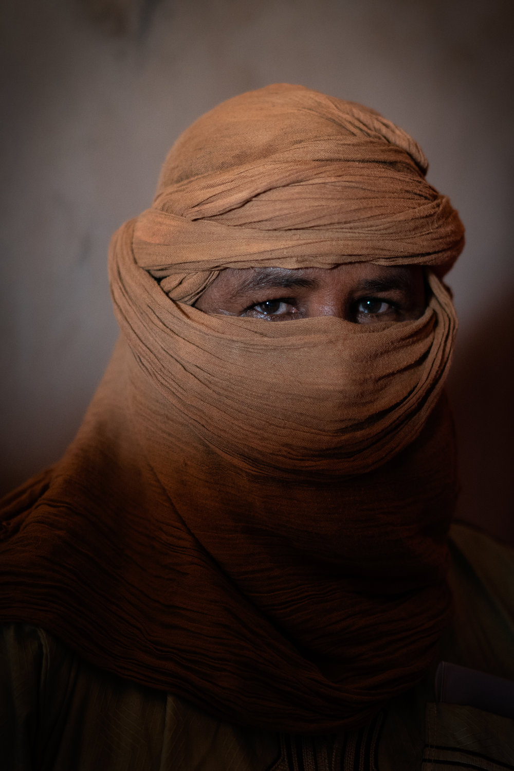 "An ex-smuggler in Agadez, Niger, Thursday, July 19, 2018. ""This place is now for the Americans and French,"" he says of Agadez, ""They took our livelihood and don't give us anything in return. Who says they can do that?"" CREDIT: Mackenzie Knowles-Coursin for The Wall Street Journal. NIGERSPY"