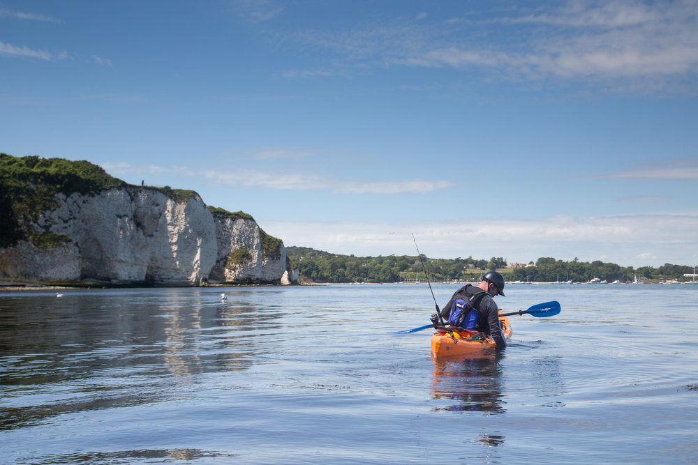 kayak fishing in Dorset with fore / adventure