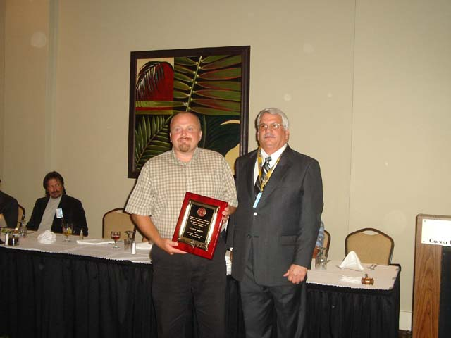Cadastralist of the Year award winner Robert Miller with President John Bausola.jpg