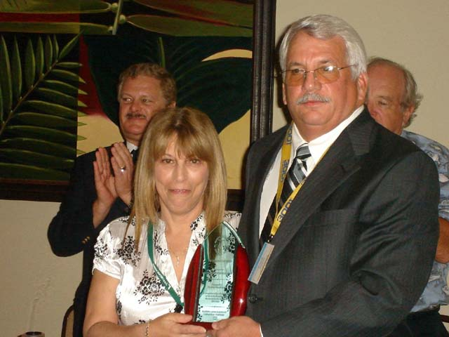 John Bausola presenting President's award to Joyce McGuire.jpg