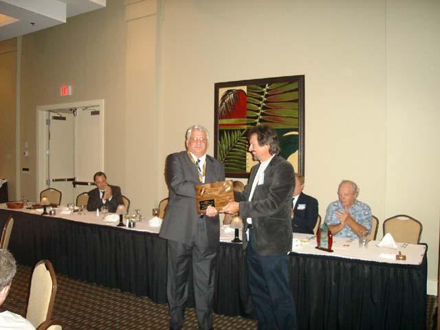New President Mike Wentworth Presenting gavel to outgoing President President John Bausola.jpg
