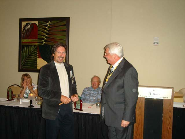 Outgoing President John Bausola presenting new President Mike Wentworth the Presidents gavel.jpg
