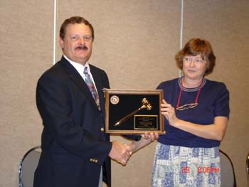 President Jeff Maasch receiving President's Plaque for service for previous year.jpg