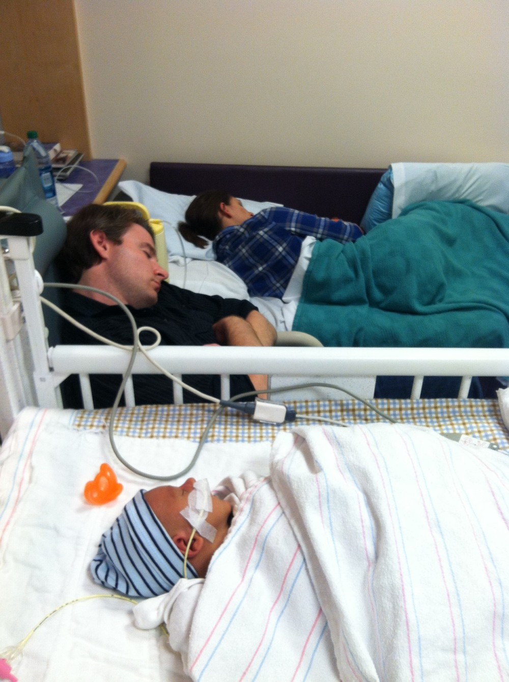 Mommy and Daddy sleeping in my NICU room.