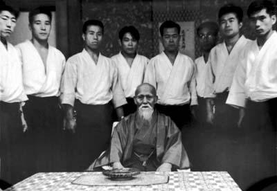 Saotome Shihan (thrid person from the left) with O Sensei in 1964.